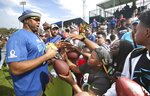 NFC Chicago Bears tackle Charles Leno Jr. signs autographs during NFL football Pro Bowl practice in Orlando, Fla., Wednesday, Jan. 23, 2019. (Stephen M. Dowell/Orlando Sentinel via AP)