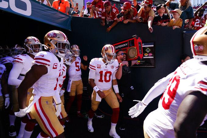 San Francisco 49ers quarterback Jimmy Garoppolo (10) prepares to run on to the field with teammates before an NFL football game against the Philadelphia Eagles on Sunday, Sept. 19, 2021, in Philadelphia. (AP Photo/Matt Slocum)