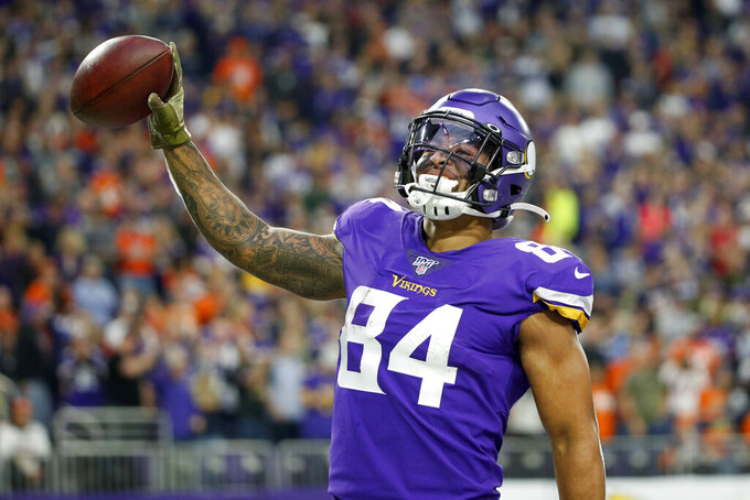 Minnesota Vikings tight end Irv Smith (84) celebrates after catching a 10-yard touchdown pass during the second half of an NFL football game against the Denver Broncos, Sunday, Nov. 17, 2019, in Minneapolis. (AP Photo/Bruce Kluckhohn)
