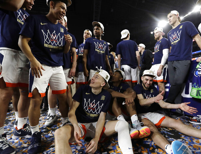 Virginia players celebrate after the championship game against Texas Tech in the Final Four NCAA college basketball tournament, Monday, April 8, 2019, in Minneapolis. Virginia won 85-77 in overtime. (AP Photo/David J. Phillip)