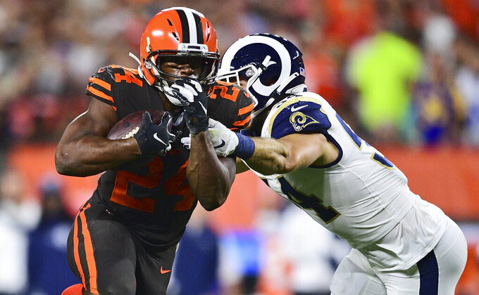 Cleveland Browns running back Nick Chubb (24) rushes against Los Angeles Rams linebacker Bryce Hager, right, during the first half of an NFL football game Sunday, Sept. 22, 2019, in Cleveland. (AP Photo/David Dermer)
