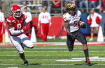 Maryland running back Anthony McFarland Jr. (5) runs by Rutgers linebacker Tyshon Fogg (8) for an 80-yard touchdown run during the third quarter of an NCAA college football game, Saturday Oct. 5, 2019, in Piscataway, N.J. (Andrew Mills/NJ Advance Media via AP)