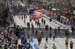 FILE - In this April 17, 2017, file photo, runners head down the stretch to the finish line in the 121st Boston Marathon in Boston. Due to the COVID-19 virus pandemic, the 124th running of the Boston Marathon was postponed from its traditional third Monday in April to Monday, Sept. 14, 2020. (AP Photo/Charles Krupa, File)