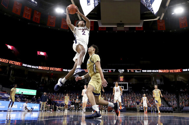Virginia guard Reece Beekman (2) shoots on a breakaway next to Georgia Tech guard Michael Devoe (0) during an NCAA college basketball game Saturday, Jan. 23, 2021, in Charlottesville, Va. (Andrew Shurtleff/The Daily Progress via AP, Pool)