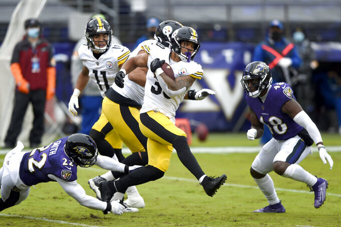 Pittsburgh Steelers running back James Conner (30) runs with the ball against the Baltimore Ravens during the first half of an NFL football game, Sunday, Nov. 1, 2020, in Baltimore. (AP Photo/Gail Burton)