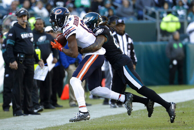 Chicago Bears' Allen Robinson, left, hangs onto a pass as Philadelphia Eagles' Ronald Darby tackles him during the first half of an NFL football game, Sunday, Nov. 3, 2019, in Philadelphia. (AP Photo/Chris Szagola)