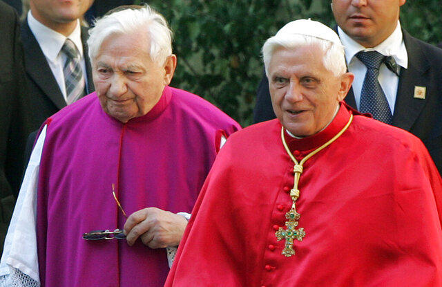 FILE - In this Sept. 13, 2006 file picture Pope Benedict XVI, right, walks with his brother priest Georg Ratzinger in Regensburg, southern Germany. The Rev. Georg Ratzinger, the older brother of Emeritus Pope Benedict XVI, who earned renown in his own right as a director of an acclaimed German boys' choir, has died at age 96. The Regensburg diocese in Bavaria, where Ratzinger lived, said in a statement on his website that he died on Wednesday, July 1, 2020. (AP Photo/Diether Endlicher, File)