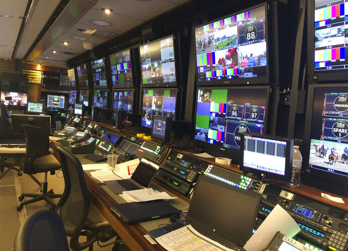 In this May 15, 2019, photo, some of the equipment in the NBC Sports television truck at Pimlico Race Course used for coverage of the Preakness Stakes horse race is shown in Baltimore. When Justify ran through the fog to win the 2018 Preakness, announcer Larry Collmus couldn't see the track. But thanks to high-definition monitors in front of him and cameras capturing the action all the way around the track, it's never an issue for him or the TV audience to see the Belmont or any Triple Crown race in any condition. (AP Photo/Stephen Whyno)