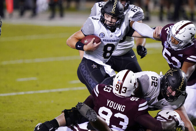 Vanderbilt quarterback Ken Seals (8) is sacked by Mississippi State defensive players during the second half of an NCAA college football game in Starkville, Miss., Saturday, Nov. 7, 2020. (AP Photo/Rogelio V. Solis)