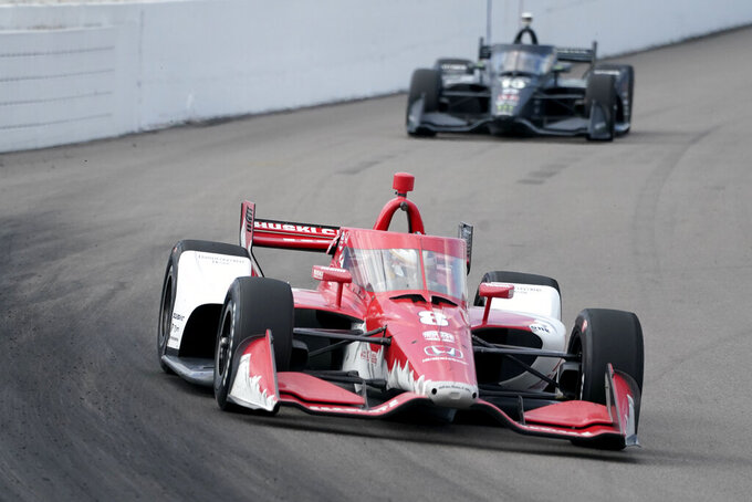 Marcus Ericsson (8) leads Felix Rosenqvist (10) during the IndyCar auto race at World Wide Technology Raceway on Sunday, Aug. 30, 2020, in Madison, Ill. (AP Photo/Jeff Roberson)