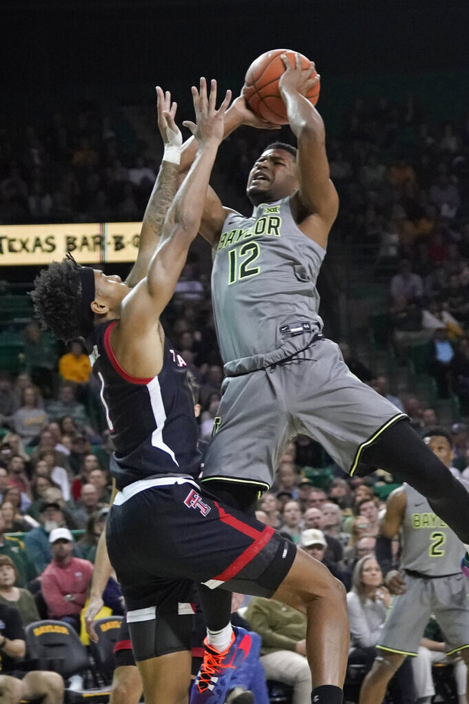 Baylor's Jared Butler (12) shoots over Texas Tech's Terrence Shannon Jr (1) during the first half of an NCAA college basketball game in Waco, Texas, Monday, March 2, 2020. (AP Photo/Chuck Burton)