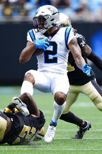 Carolina Panthers wide receiver D.J. Moore is tackled by New Orleans Saints strong safety Malcolm Jenkins during the first half of an NFL football game Sunday, Sept. 19, 2021, in Charlotte, N.C. (AP Photo/Jacob Kupferman)