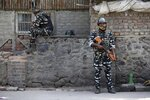 Indian paramilitary soldiers stand guard outside the main telephone exchange building in Srinagar, Indian controlled Kashmir, Thursday, Sept. 5, 2019. Indian authorities say they have restored all landline phones in the Himalayan region of Kashmir after communication services, including mobile Internet, were suspended on Aug. 5, when India's Hindu-nationalist government revoked the disputed Muslim-majority region's special constitutional status and put the region under strict security lockdown. (AP Photo/Mukhtar Khan)
