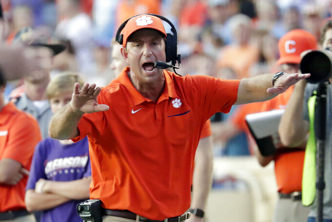 Clemson head coach Dabo Swinney yells to an official during the fourth quarter of an NCAA college football game against North Carolina in Chapel Hill, N.C., Saturday, Sept. 28, 2019. (AP Photo/Chris Seward)