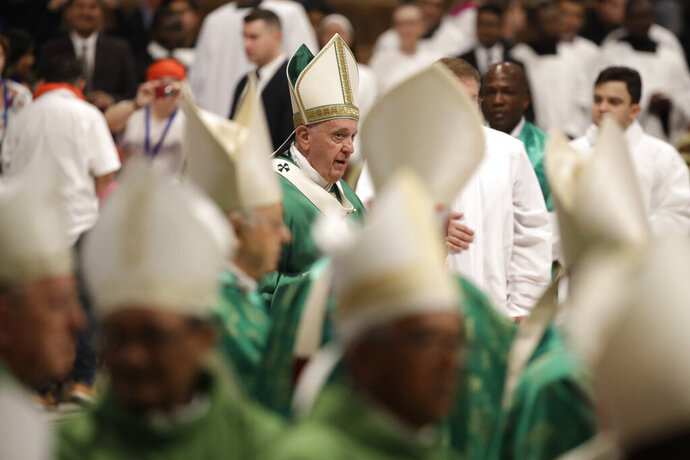 FILE - In this Oct. 27, 2019, file photo, Pope Francis leaves after a Mass for the closing of Amazon Synod in St. Peter's Basilica at the Vatican. Germany's Catholics reacted enthusiastically when bishops in the Amazon called for the ordination of married men as priests to address the clergy shortage in that region. But there is resistance elsewhere for the proposal that would overturn centuries of tradition, with the conservative Roman Catholic establishment making sure its voice is heard as Pope Francis prepares his own document on the issue. (AP Photo/Alessandra Tarantino, File)