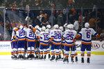 New York Islanders celebrate after winning an NHL hockey game against the Philadelphia Flyers, Saturday, Nov. 16, 2019, in Philadelphia. New York won 4-3 in a shootout. (AP Photo/Matt Slocum)