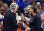 FILE - In this Saturday, Sept. 8, 2018, file photo, Serena Williams, right, talks with referee Brian Earley during the women's final of the U.S. Open tennis tournament against Naomi Osaka, of Japan, in New York. Some black women say Serena Williams' experience at the U.S. Open final resonates with them. They say they are often forced to watch their tone and words in the workplace in ways that men and other women are not. Otherwise, they say, they risk being branded an