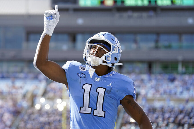 North Carolina wide receiver Josh Downs (11) reacts following a touchdown against Duke during the second half of an NCAA college football game in Chapel Hill, N.C., Saturday, Oct. 2, 2021. (AP Photo/Gerry Broome)