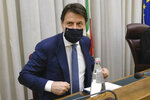 Italian Premier Giuseppe Conte attends an hearing of a Parliamentary investigative commission, at the Senate in Rome, Thursday, June 18, 2020. Italian Premier Giuseppe Conte was heard by a Parliamentary investigative commission on the slain of Italian researcher Giulio Regeni who was murdered in Cairo in 2016. Giulio Regeni, 28, an Italian doctoral student disappeared in Cairo on Jan. 25, the anniversary of Egypt's 2011 uprising, a day when security forces were on high alert and on the streets in force to prevent any demonstrations or protests. His body, stabbed repeatedly and exhibiting cigarette burns and other signs of torture, was reported found on Feb. 3. (Mauro Scrobogna/LaPresse via AP)