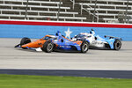 Scott Dixon tries to hold off Graham Rahal during an IndyCar Series auto race at Texas Motor Speedway on Sunday, May 2, 2021, in Fort Worth, Texas. (AP Photo/Richard W. Rodriguez)
