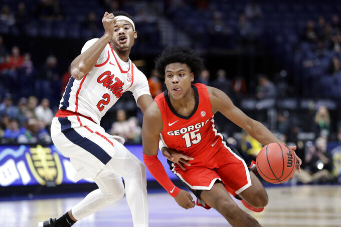 Georgia guard Sahvir Wheeler (15) drives against Mississippi's Devontae Shuler (2) in the first half of an NCAA college basketball game in the Southeastern Conference Tournament Wednesday, March 11, 2020, in Nashville, Tenn. (AP Photo/Mark Humphrey)