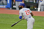 Chicago Cubs' Jason Heyward watches his ball after hitting an RBI-single in the second inning in a baseball game against the Cleveland Indians, Tuesday, Aug. 11, 2020, in Cleveland. (AP Photo/Tony Dejak)