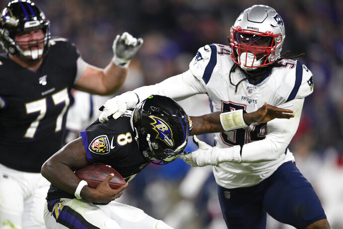 FILE - In this Nov. 3, 2019, file photo, New England Patriots outside linebacker Dont'a Hightower (54) tackles Baltimore Ravens quarterback Lamar Jackson (8) during the first half of an NFL football game in Baltimore. A total of 66 players have opted out of the 2020 NFL season due to the coronavirus pandemic, including Hightower. (AP Photo/Nick Wass, File)