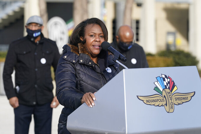 Rep. Robin Shackleford speaks after receiving her Johnson & Johnson COVID-19  vaccine during the state's first mass vaccination clinic at the Indianapolis Motor Speedway, Friday, March 5, 2021, in Indianapolis. The state health department said nearly 17,000 people had filled up four days of appointments for the speedway clinic being held Friday through Monday. (AP Photo/Darron Cummings)