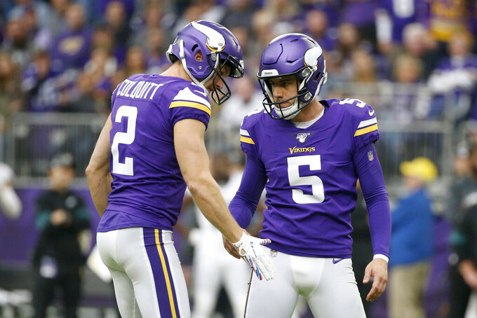 Minnesota Vikings kicker Dan Bailey (5) celebrates with teammate Britton Colquitt, left, after kicking 39-yard field goal during the first half of an NFL football game against the Philadelphia Eagles, Sunday, Oct. 13, 2019, in Minneapolis. (AP Photo/Bruce Kluckhohn)