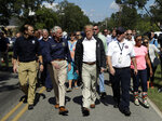 President Donald Trump visits a neighborhood impacted by Hurricane Florence, Wednesday, Sept. 19, 2018, in Conway, S.C. At left is FEMA Administrator Brock Long and South Carolina Gov. Henry McMaster, second from left. (AP Photo/Evan Vucci)