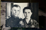 FILE - This Tuesday, April 5, 2011 file photo, shows an undated photo of the first man in space Yuri Gagarin and his wife Valentina on a display at the upper house of Russian parliament in Moscow, Russia. The successful one-orbit flight on April 12, 1961 made the 27-year-old Gagarin a national hero and cemented Soviet supremacy in space until the United States put a man on the moon more than eight years later. (AP Photo/Alexander Zemlianichenko, File)