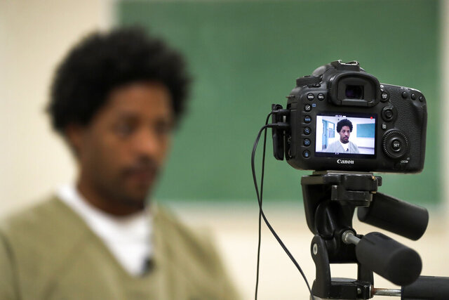 In this Thursday, March 12, 2020 photo, Cook County Jail inmate Sirjerathan Wilson, is seen on camera as he talks with The Associated Press about his early jailhouse voting experience for the upcoming March 17, Illinois primary, in Chicago. (AP Photo/Charles Rex Arbogast)