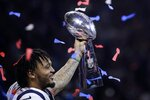 New England Patriots' Patrick Chung lifts the trophy after the NFL Super Bowl 53 football game against the Los Angeles Rams, Sunday, Feb. 3, 2019, in Atlanta. The Patriots won 13-3. (AP Photo/Patrick Semansky)