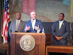 Louisiana Gov. John Bel Edwards talks to the media after Republican lawmakers failed in their effort to override any of his vetoes in a two-day legislative gathering that ended Wednesday, July 21, 2021, in Baton Rouge, La. To the left of Edwards is Senate Democratic leader Gerald Boudreaux of Lafayette, and to his right is House Democratic leader Sam Jenkins of Shreveport. (AP Photo/Melinda Deslatte)