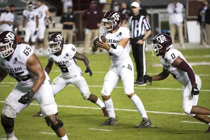 Texas A&M quarterback Kellen Mond (11) takes a snap during the second half of the team's NCAA college football game against South Carolina on Saturday, Nov. 7, 2020, in Columbia, S.C. Texas A&M won 48-3. (AP Photo/Sean Rayford)