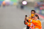 Mclaren driver Daniel Ricciardo of Australia has a picture with a fan ahead of Sunday's Formula One Dutch Grand Prix at the Zandvoort racetrack, Netherlands, Thursday, Sept. 2, 2021. (AP Photo/Francisco Seco)