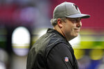 Atlanta Falcons head coach Arthur Smith watches teams warm up before the first half of a preseason NFL football game between the Atlanta Falcons and the Tennessee Titans, Friday, Aug. 13, 2021, in Atlanta. (AP Photo/Brynn Anderson)
