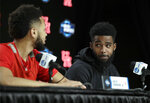 Houston's Corey Davis Jr., right, looks at teammate Galen Robinson Jr. as they take part in a news conference at the NCAA men's college basketball tournament Thursday, March 28, 2019, in Kansas City, Mo. Houston plays Kentucky in a Midwest Regional semifinal on Friday. (AP Photo/Jeff Roberson)