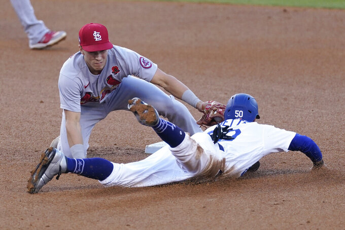 Los Angeles Dodgers' Mookie Betts (50) is caught stealing second by St. Louis Cardinals second baseman Tommy Edman (19) during the third inning of a baseball game Monday, May 31, 2021, in Los Angeles. (AP Photo/Ashley Landis)