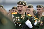 FILE - In this file photo taken on Saturday, June 20, 2020, a Russian soldier sings a combat song as he marches toward Red Square to attend a dress rehearsal for the Victory Day military parade in Moscow, Russia. A massive military parade that was postponed by the coronavirus will roll through Red Square this week to celebrate the 75th anniversary of the end of World War II in Europe, even though Russia is continuing to register a steady rise in infections. (AP Photo/Alexander Zemlianichenko, File)