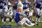 Florida wide receiver Van Jefferson (12) catches a pass in the end zone for a 6-yard touchdown in front of Charleston Southern defensive back Shadarius Hopkins (6) and defensive back James Allen (13) during the first half of an NCAA college football game, Saturday, Sept. 1, 2018, in Gainesville, Fla. (AP Photo/Phelan M. Ebenhack)