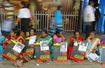 FILE - In this April 6, 2015, file photo, Sri Lankan ethnic Tamil women sit holding placards with portraits of their missing relatives as they protest out side a railway station in Colombo, Sri Lanka. Sri Lankan President Maithripala Sirisena has kept his country's internal political rift from spilling over to a United Nations human rights council meeting this week by abandoning plans to oppose his prime minister's decision to co-sponsor a resolution that would give the island nation more time to address war crime allegations stemming from its long civil war. The co-resolution to be adopted on March 21, 2019, would give Sri Lanka two more years to investigate and prosecute suspects of rights violations. (AP Photo/Eranga Jayawardena, File)