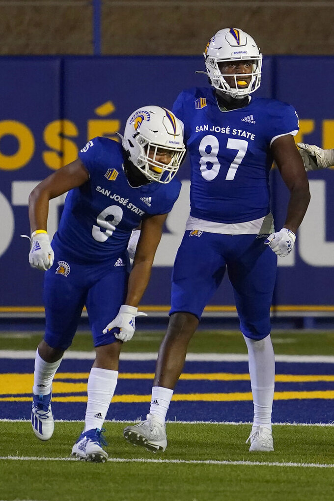 San Jose State tight end Derrick Deese Jr. (87) celebrates after catching a touchdown pass with wide receiver Isaiah Hamilton (9) during the second half of an NCAA college football game against Air Force in San Jose, Calif., Saturday, Oct. 24, 2020. (AP Photo/Jeff Chiu)