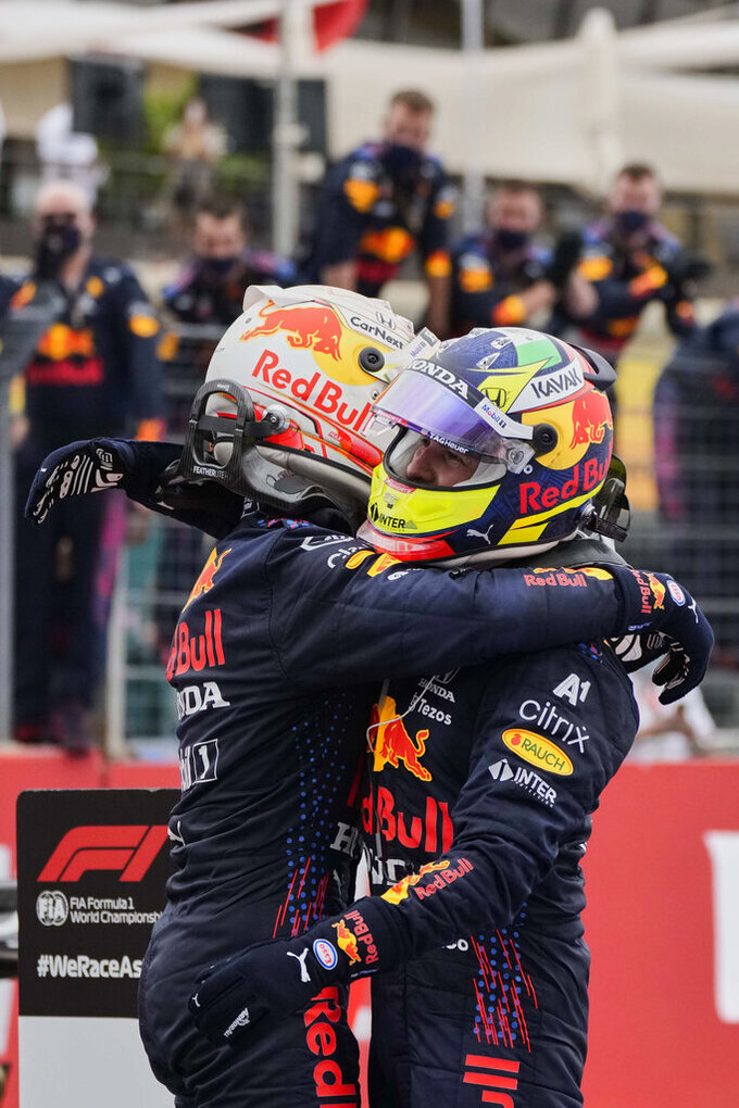 Red Bull driver Max Verstappen of the Netherlands, left, reacts after winning the French Formula One Grand Prix with third place Red Bull driver Sergio Perez of Mexico at the Paul Ricard racetrack in Le Castellet, southern France, Sunday, June 20, 2021. (AP Photo/Francois Mori)