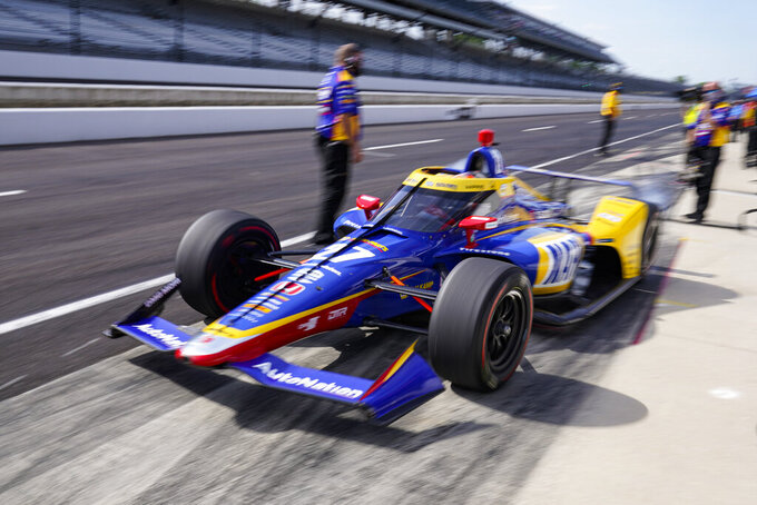 Alexander Rossi pulls out of the pit area during practice for the Indianapolis 500 auto race at Indianapolis Motor Speedway in Indianapolis, Friday, May 21, 2021. (AP Photo/Michael Conroy)