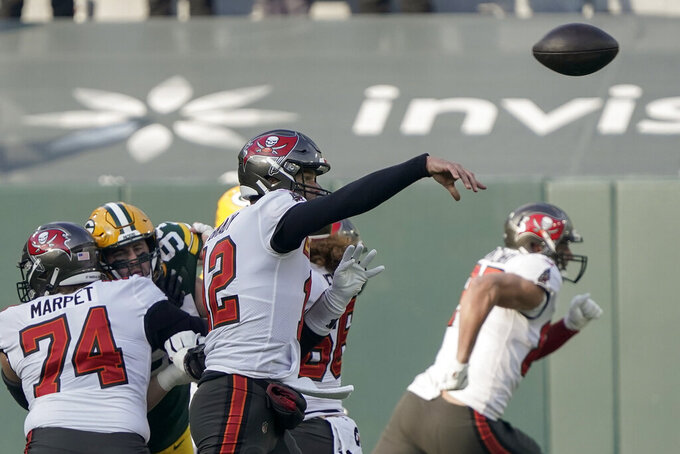 Tampa Bay Buccaneers quarterback Tom Brady (12) passes during the first half of the NFC championship NFL football game against the Green Bay Packers in Green Bay, Wis., Sunday, Jan. 24, 2021. (AP Photo/Morry Gash)