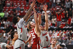 Texas Tech's Kyler Edwards (11), Clarence Nadolny (3) and Oklahoma's Brady Manek (35) try to rebound the ball during the second half of an NCAA college basketball game, Monday, Feb. 1, 2021, in Lubbock, Texas. (AP Photo/Brad Tollefson)