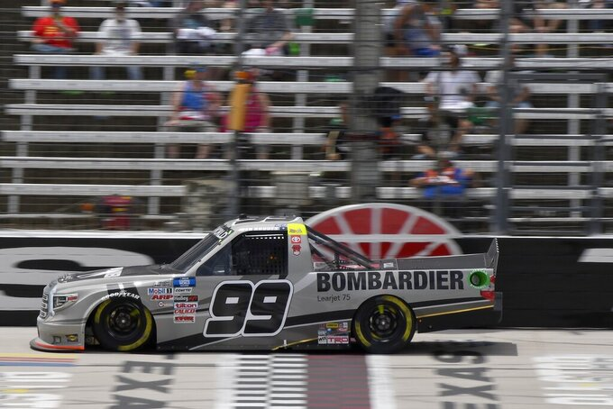 Ben Rhodes drives down the front stretch during a NASCAR Truck Series auto race at Texas Motor Speedway in Fort Worth, Texas, Saturday, June 12, 2021. (AP Photo/Larry Papke)
