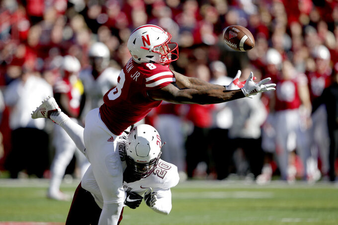 FILE - In this Oct. 27, 2018, file photo, Nebraska wide receiver Stanley Morgan Jr. (8) reaches out for the ball against Bethune-Cookman cornerback Trevor Merritt (20) during the first half of an NCAA college football game in Lincoln, Neb. Morgan needs four receptions and 91 yards in the final two games to pass Kenny Bell in both categories on the Nebraska all-time receiving chart. (AP Photo/Nati Harnik, file)