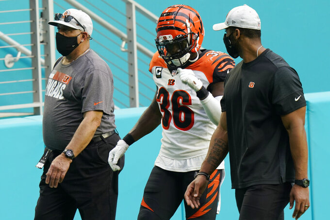 Cincinnati Bengals strong safety Shawn Williams (36) is escorted off the field after he was disqualified following a fight during the second half of an NFL football game against the Miami Dolphins, Sunday, Dec. 6, 2020, in Miami Gardens, Fla. (AP Photo/Lynne Sladky)